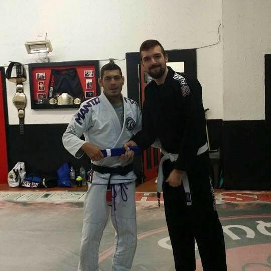 Chris Marzella receiving his blue belt from Marcos