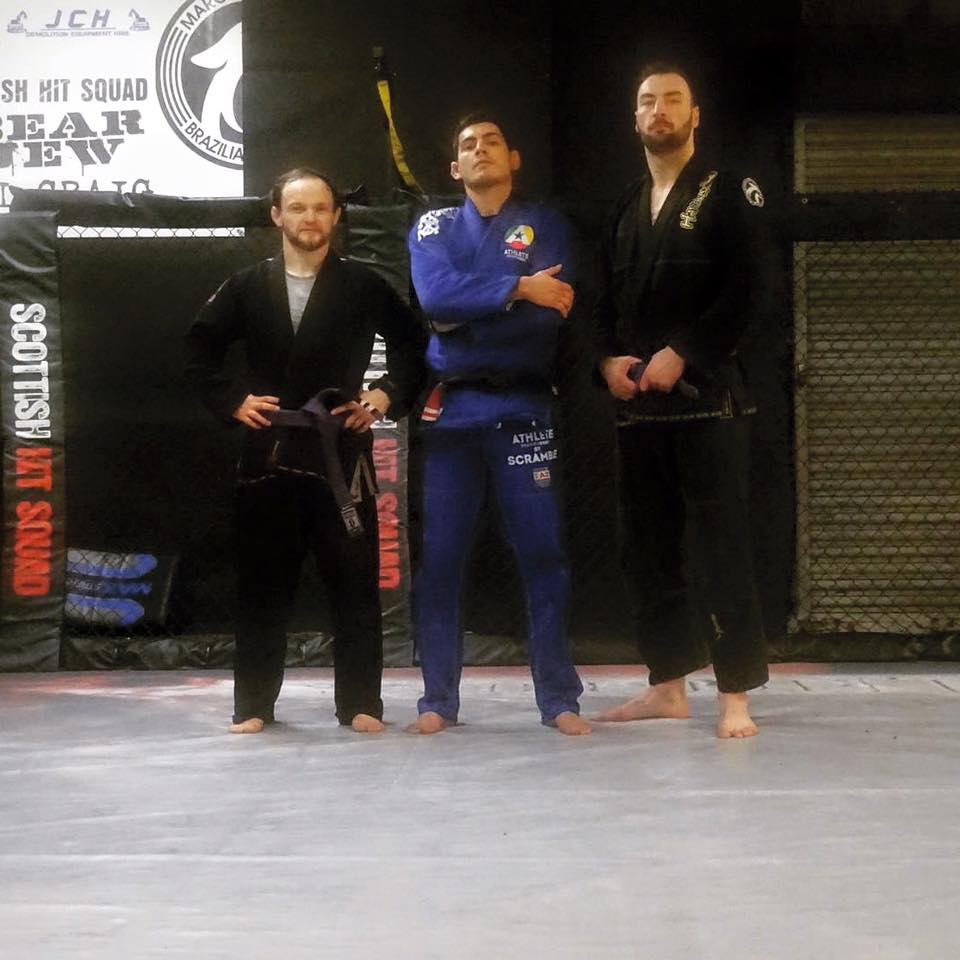 Marcos with two of his purple belts - Brian and Paul Craig